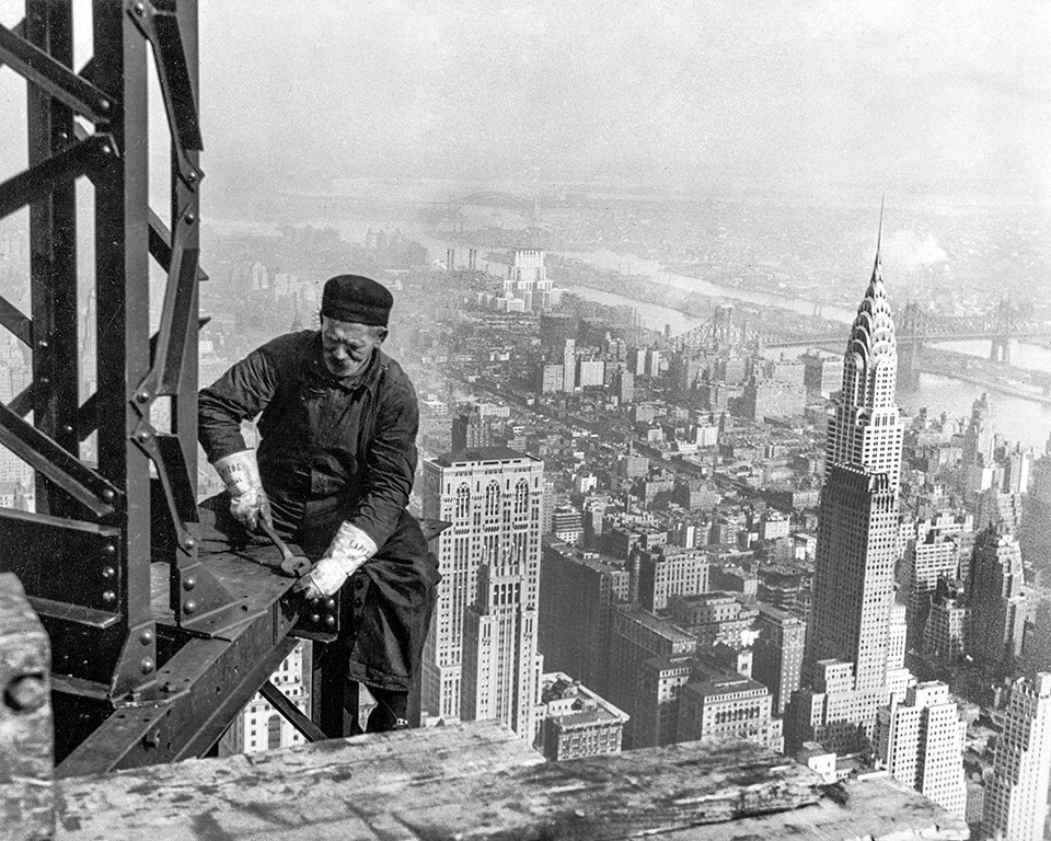 Workman on the framework of the Empire State Building New York City 1931
