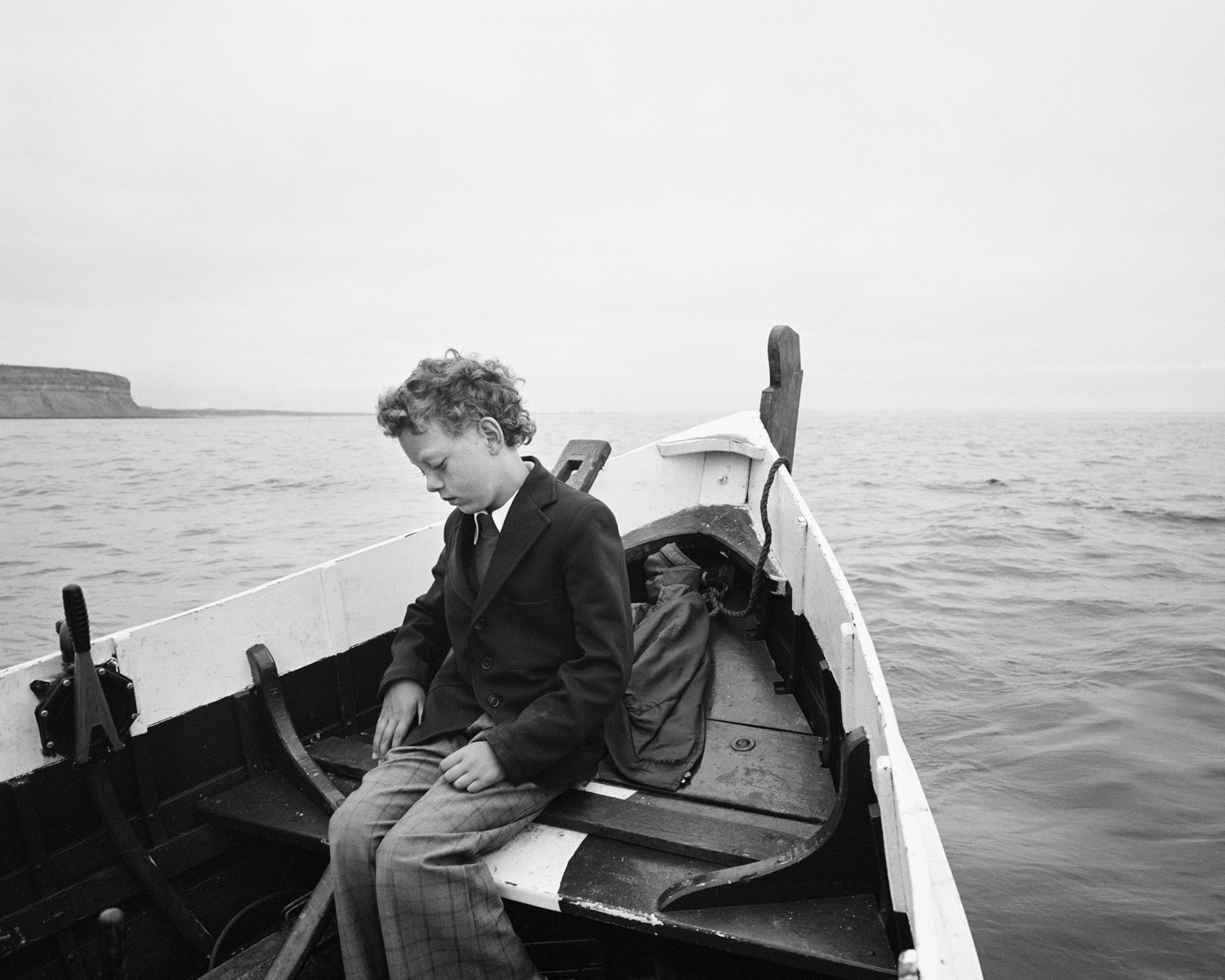Simon being taken to sea for the first time since his father drowned Skinningrove North Yorkshire 1983